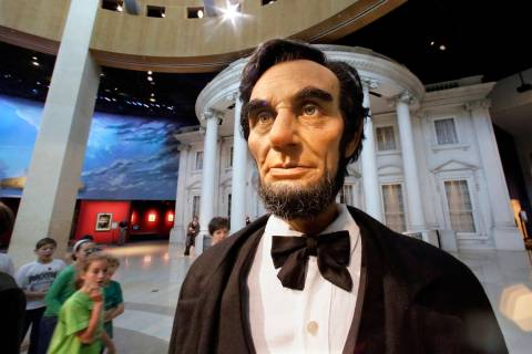 In this Friday, Nov. 15, 2013 photo, school groups and visitors tour the Abraham Lincoln Presid ...