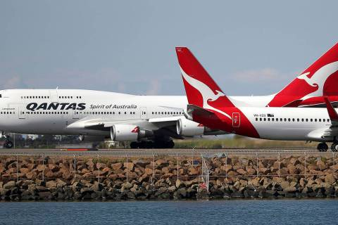 FILE - In this Aug. 20, 2015 file photo, two Qantas planes taxi on the runway at Sydney Airport ...