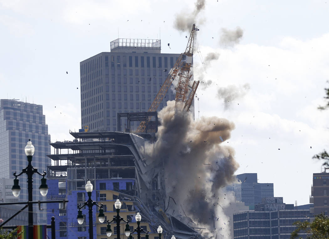 Two large cranes from the Hard Rock Hotel construction collapse come crashing down after being ...