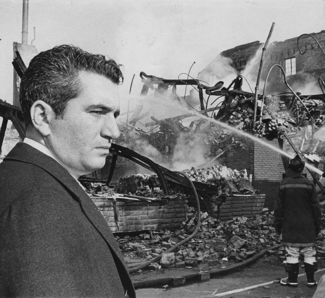 In this 1968 photo Baltimore Mayor Thomas D'Alesandro looks at the ruins of a Baltimore buildin ...