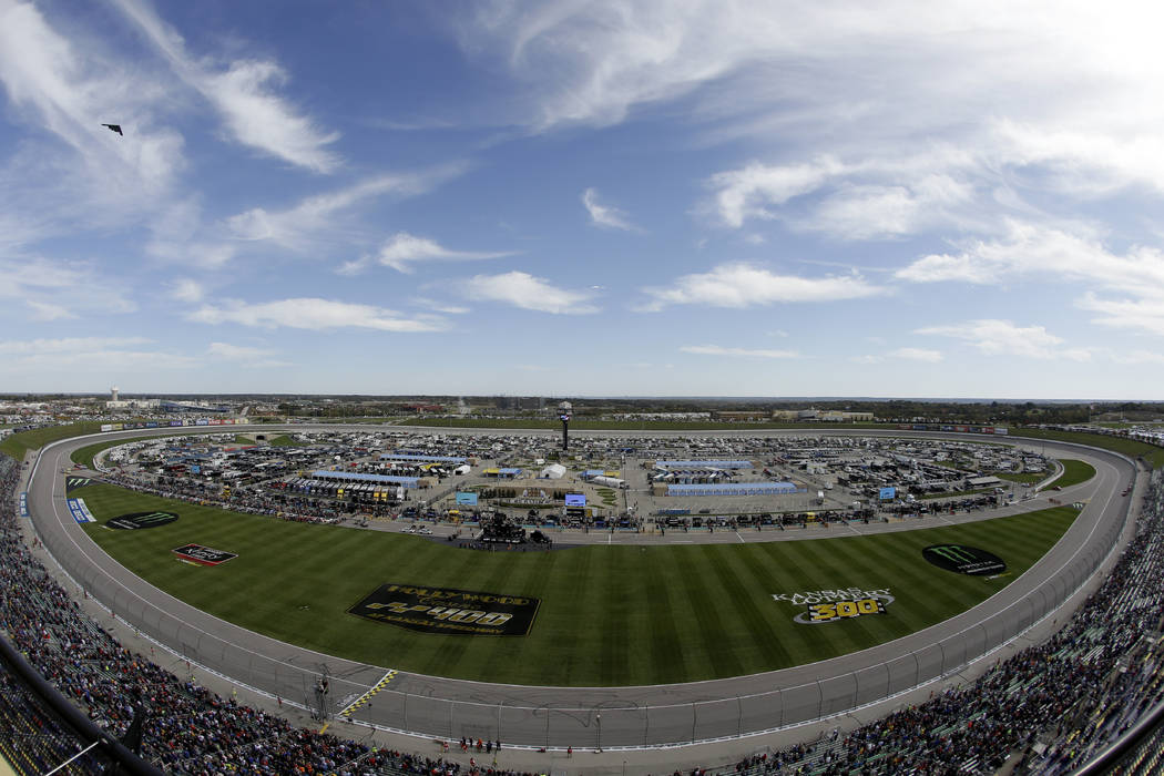 A B-2 Stealth bomber flies by before a NASCAR Cup Series auto race at Kansas Speedway in Kansas ...
