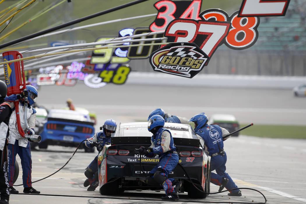 Chris Buescher (37) pits during a NASCAR Cup Series auto race at Kansas Speedway in Kansas City ...