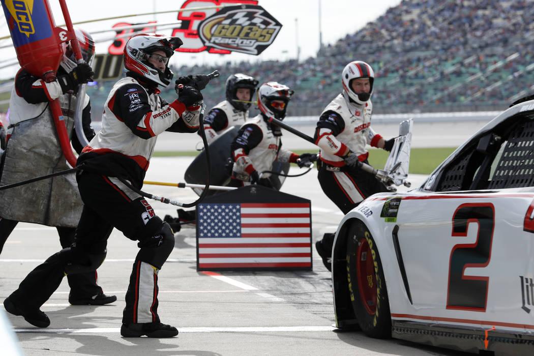 Brad Keselowski (2) pits during a NASCAR Cup Series auto race at Kansas Speedway in Kansas City ...