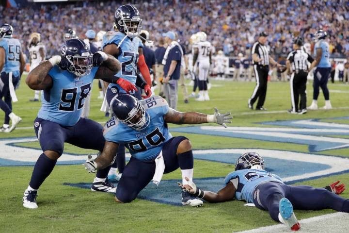 Tennessee Titans defenders Tennessee Titans defenders Jeffery Simmons (98) and Jurrell Casey (9 ...