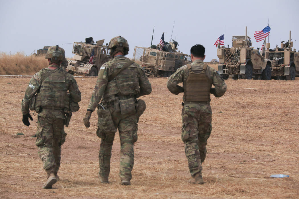 American military convoy stops near the town of Tel Tamr, north Syria, Sunday, Oct. 20, 2019. K ...