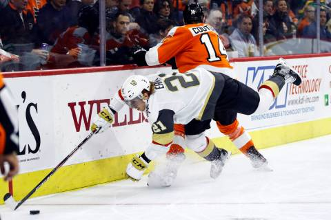 Vegas Golden Knights' Cody Eakin (21) dives for the puck past Philadelphia Flyers' Sean Couturi ...