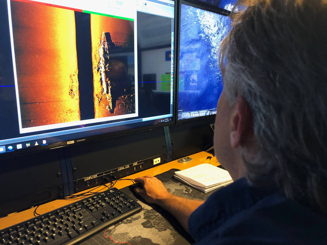 Rob Kraft, director of undersea operations at Vulcan Inc., reviews sonar scans of a warship fro ...