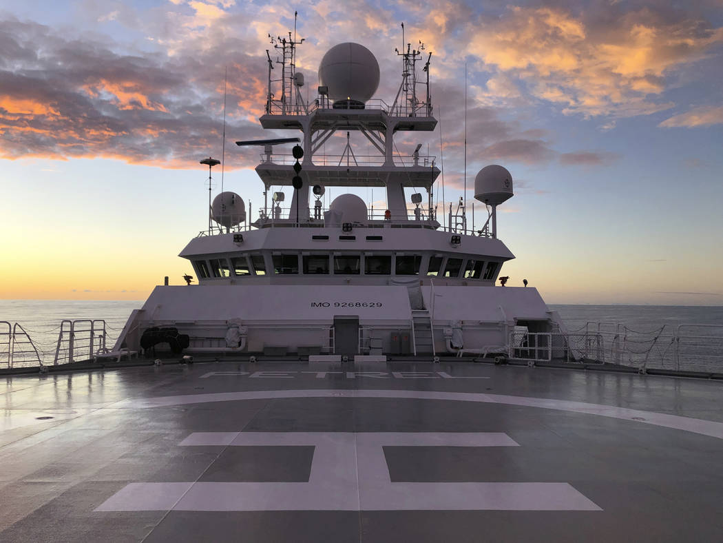 The sun rises over Vulcan Inc.'s research vessel Petrel nearly 200 miles off Midway Atoll in th ...