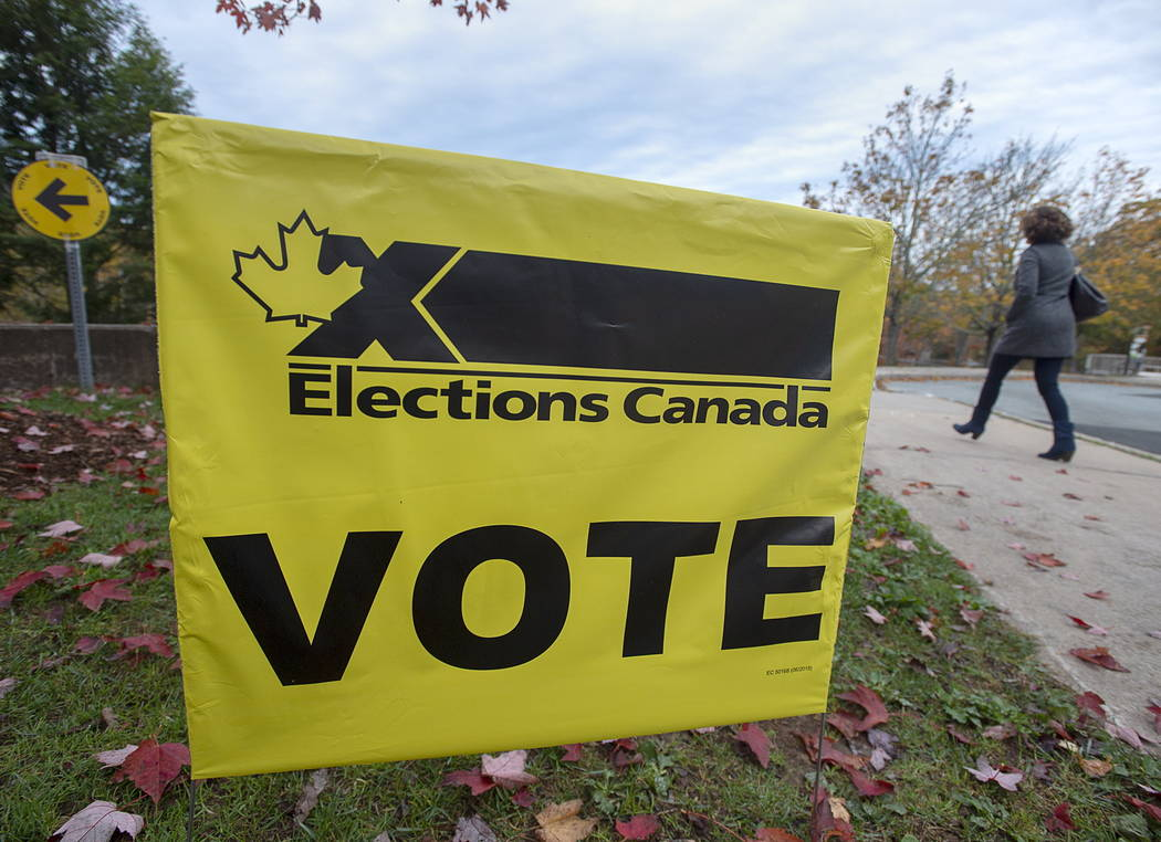 A voter heads to cast their vote in Canada's federal election at the Fairbanks Interpretation C ...