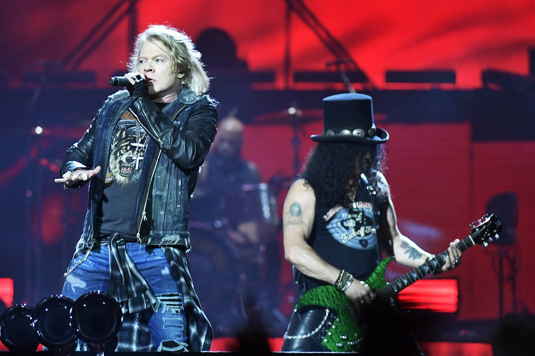 Axl Rose, lead singer, and Slash, guitarist of U.S. rock band Guns N' Roses, performs during a ...