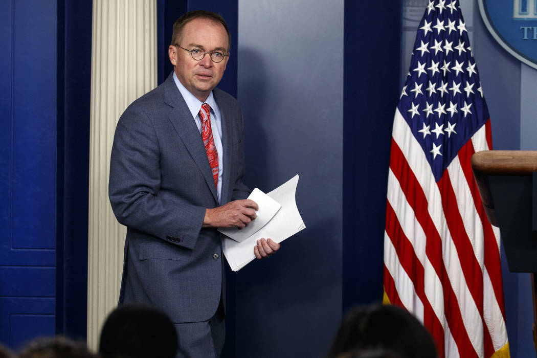FILE - In this Thursday, Oct. 17, 2019, file photo, White House chief of staff Mick Mulvaney ar ...