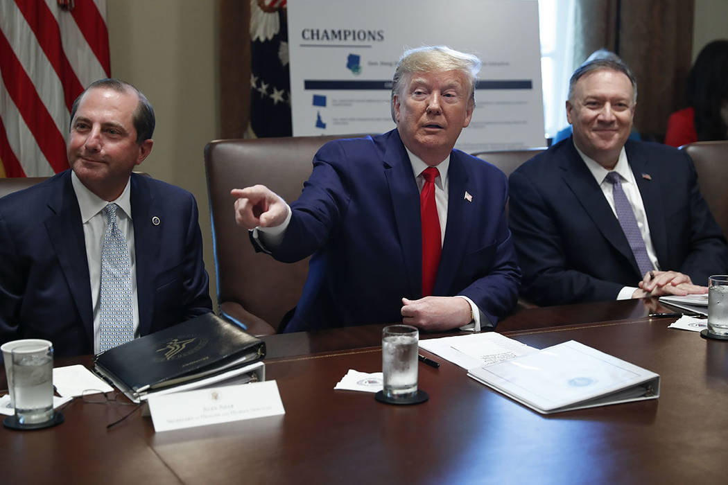 President Donald Trump, center, gestures during a Cabinet meeting in the Cabinet Room of the Wh ...