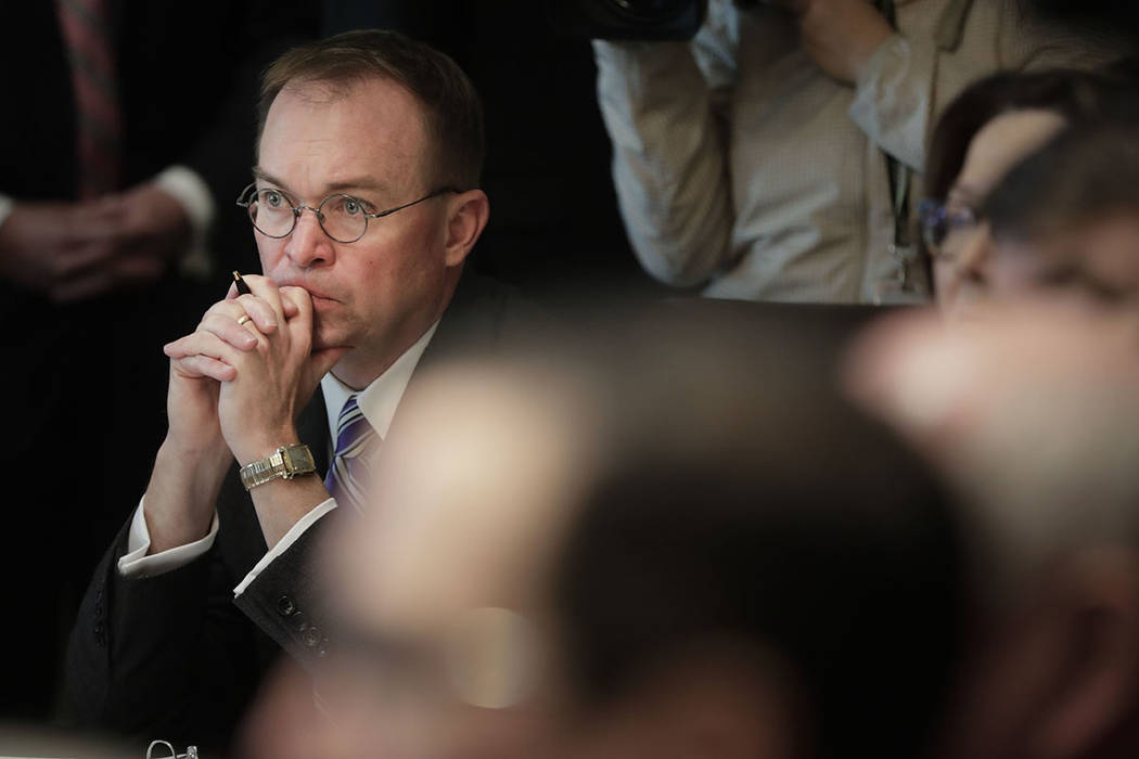 White House Chief of Staff Mick Mulvaney listens as President Donald Trump speaks during a Cabi ...