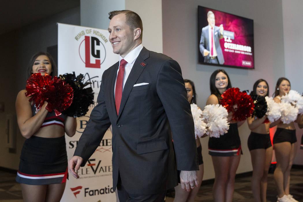 New UNLV men's basketball coach T.J. Otzelberger walks to the podium at the Strip View Pavilion ...