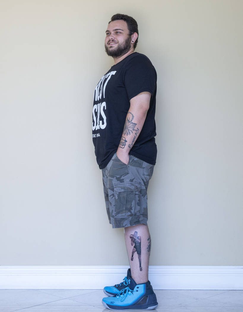 Local sports fan Trevor La Porte shows his recent tattoo of Las Vegas Aces player Dearica Hamby ...