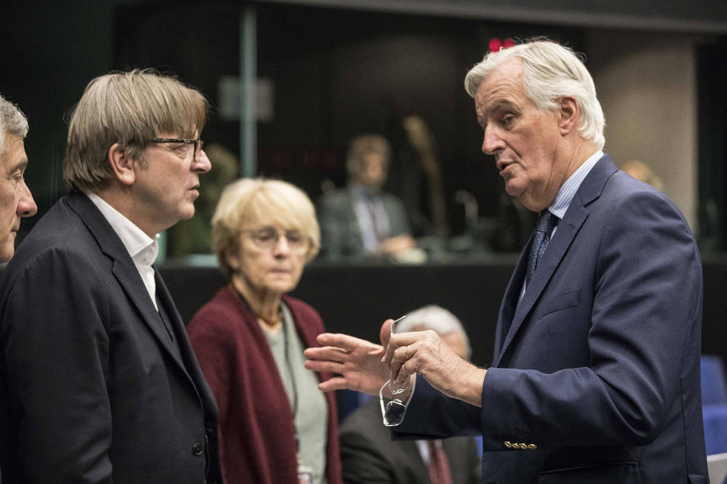 CORRECTING DATE TO MONDAY - Chief Brexit negotiator for the EU Michel Barnier, right, talks wit ...