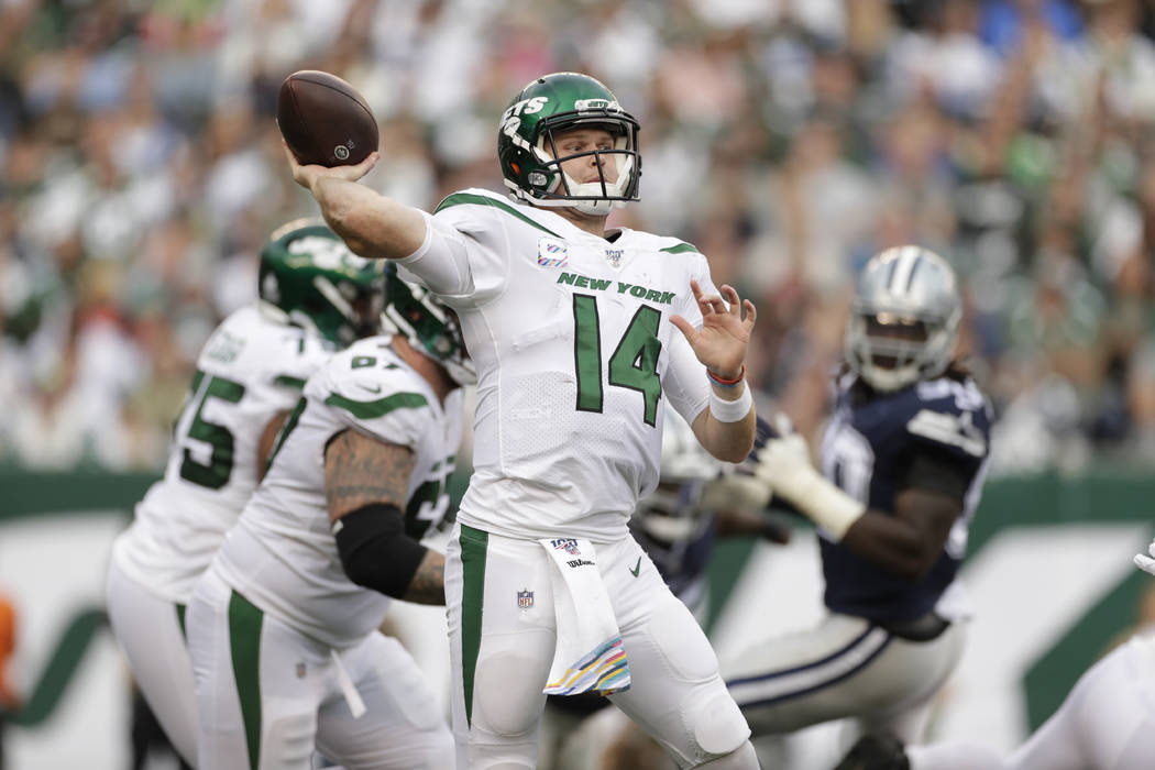 New York Jets quarterback Sam Darnold throws during the first half of an NFL football game agai ...