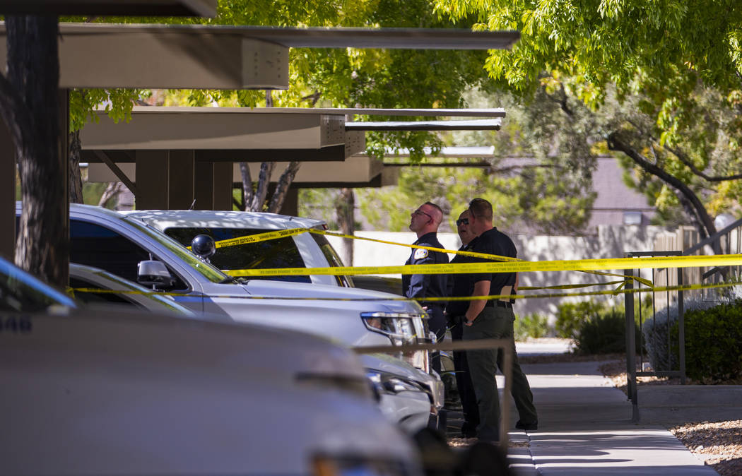 Officers work the scene of an officer involved shooting at The Equestrian on Eastern Apartments ...