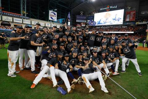 Houston Astros pose after winning Game 6 of baseball's American League Championship Series agai ...