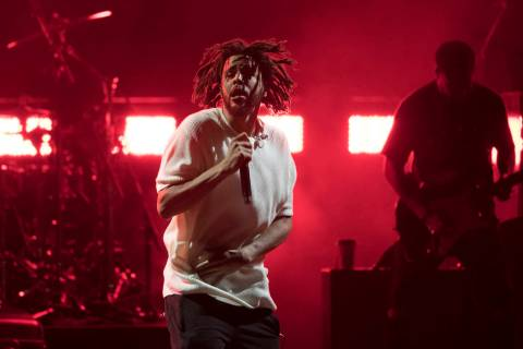 J. Cole performs during a campaign rally for Democratic presidential candidate Hillary Clinton ...