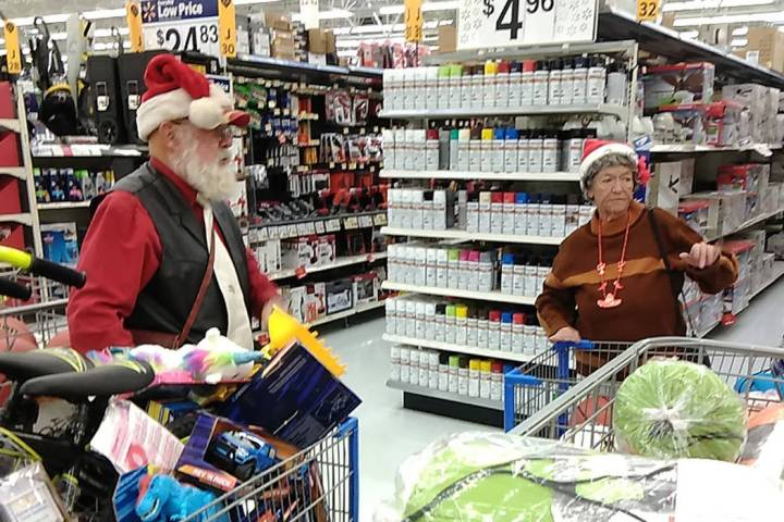 Fred Summers and his wife Patty fill their shopping carts with a variety of toys during their C ...