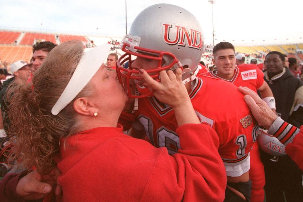 News UNLV freshman quarterback Jon Denton is kissed by his mother Karen Denton after the Rebels ...