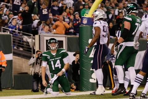 New York Jets quarterback Sam Darnold (14) reacts after the New England Patriots scored a safet ...