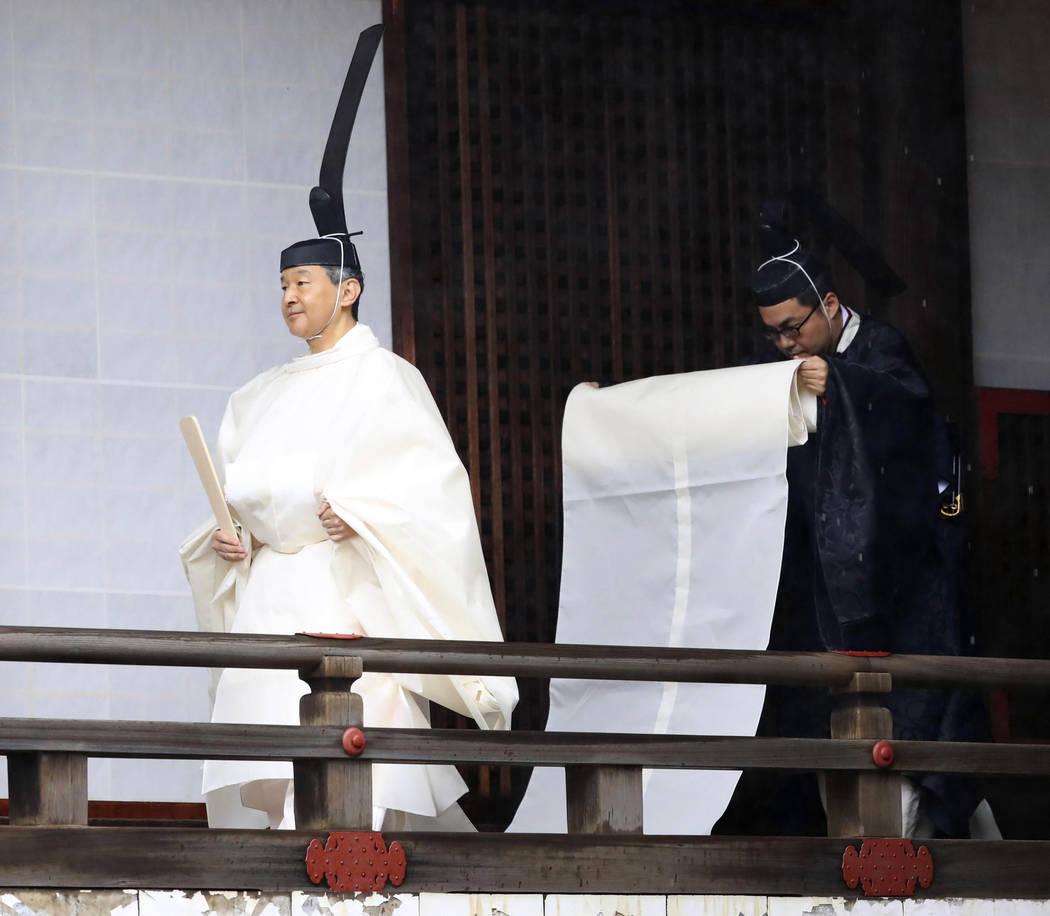 "Japan's Emperor Naruhito, in a white robe, visits ""Kashikodokoro"", a shrine at t ..."