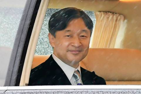 Japan's Emperor Naruhito depart for the Imperial Palace in Tokyo, Tuesday, Oct. 22, 2019. Empe ...