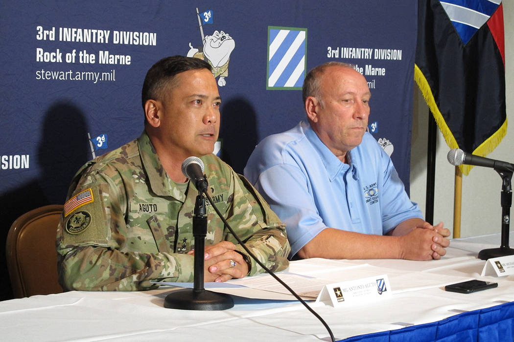 Army Maj. Gen. Antonio Aguto, left, and Army accident investigator Michael Barksdale hold a new ...