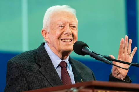 In a Sept. 18, 2019, file photo, former President Jimmy Carter acknowledges a student who's que ...