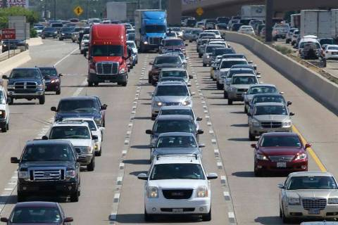 A July 1, 2016, file photo, shows drivers work their way out of Dallas during rush hour. The U. ...
