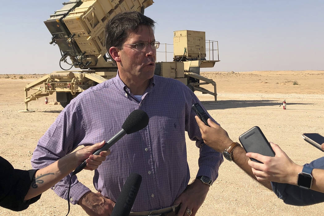 Defense Secretary Mark Esper talks to reporters at Prince Sultan Air Base in Saudi Arabia, Tues ...