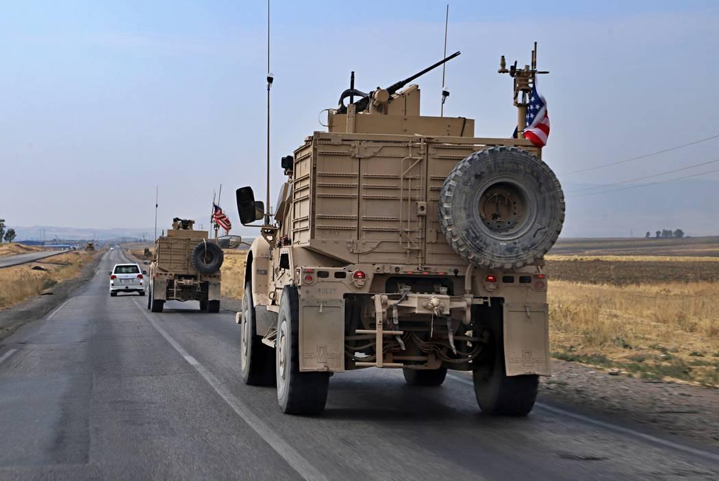 A U.S. military convoy arrives near Dahuk, Iraqi, Monday, Oct. 21, 2019. Defense Secretary Mark ...