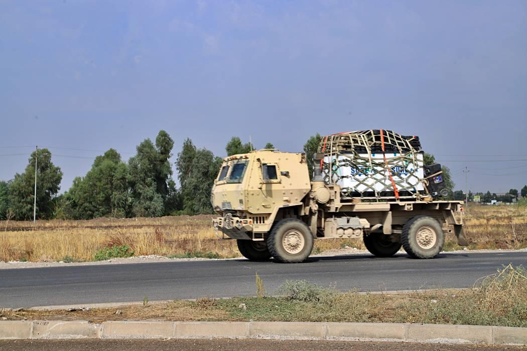 A U.S. military vehicle, part of a convoy, arrives near Dahuk, Iraqi, Monday, Oct. 21, 2019. De ...