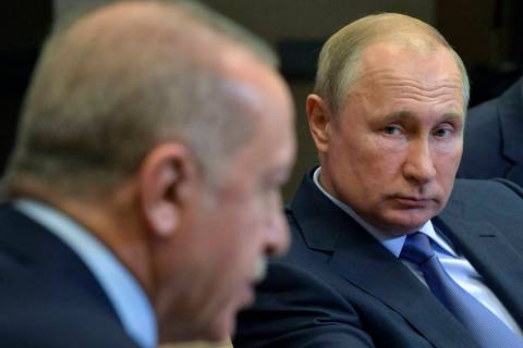 Russian President Vladimir Putin, right, listens to Turkish President Recep Tayyip Erdogan duri ...