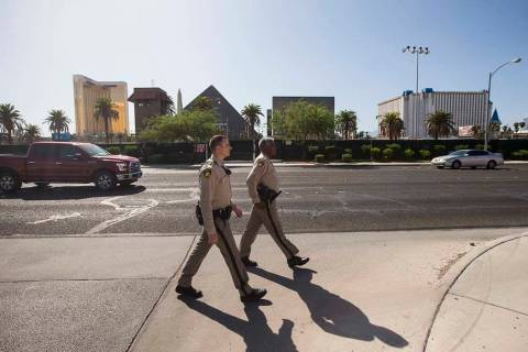 Las Vegas police officer Brandon Engstrom, left, and George Gafford, who works in Metro's Polic ...