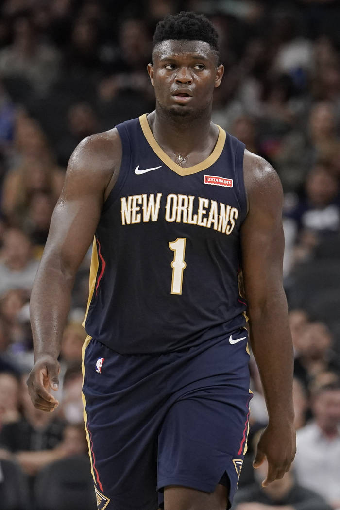 New Orleans Pelicans' Zion Williamson walks upcourt during the second half of an NBA preseason ...