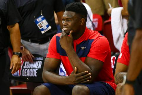 New Orleans Pelicans' Zion Williamson sits on the bench before the start of a game between the ...