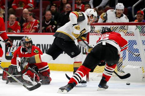 Vegas Golden Knights center Cody Eakin (21) scores a goal past Chicago Blackhawks goaltender Co ...