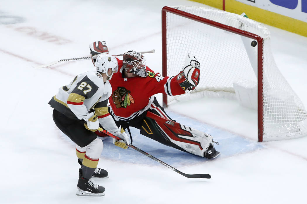 Vegas Golden Knights defenseman Shea Theodore (27) scores past Chicago Blackhawks goaltender Ro ...