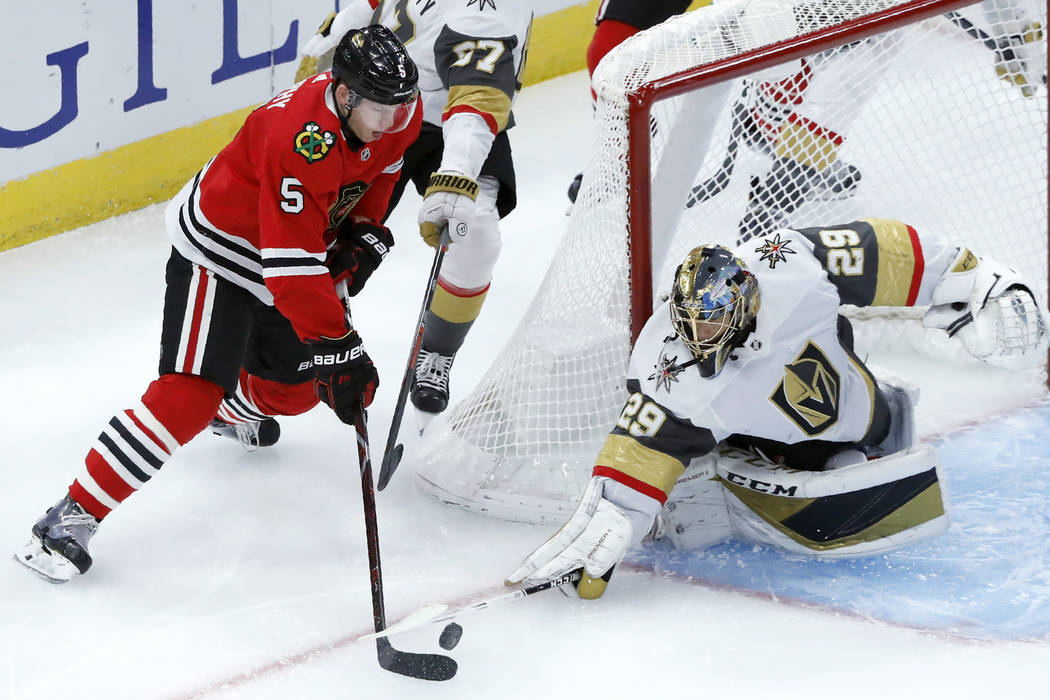 Vegas Golden Knights goaltender Marc-Andre Fleury (29) poke-checks the puck away from Chicago B ...