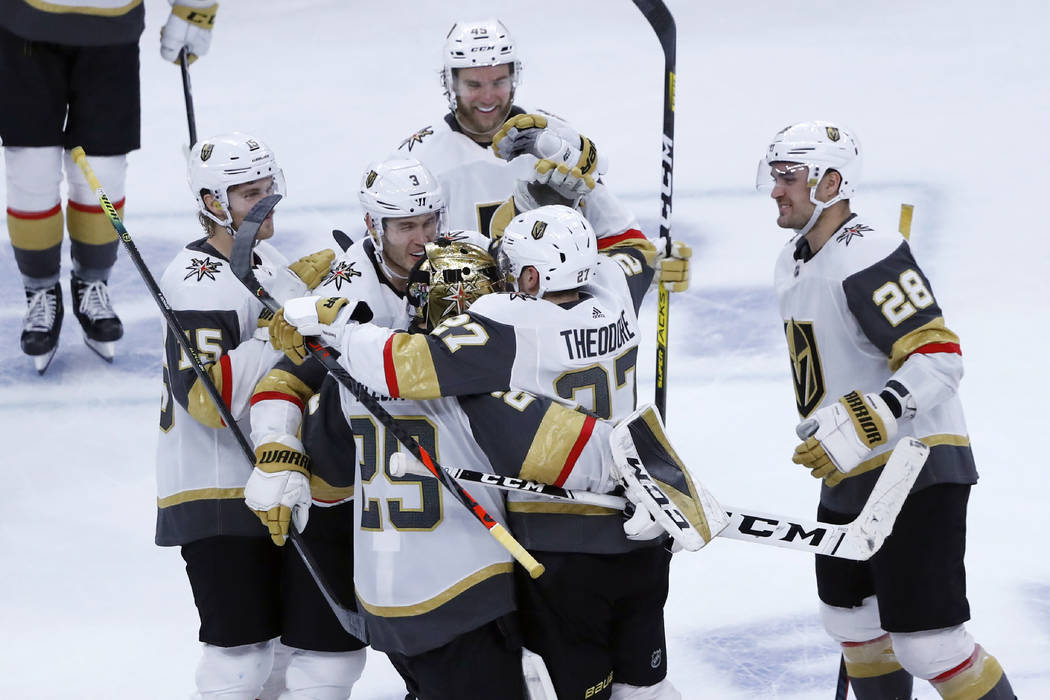 The Vegas Golden Knights celebrate Shea Theodore's shootout goal against the Chicago Blackhawks ...