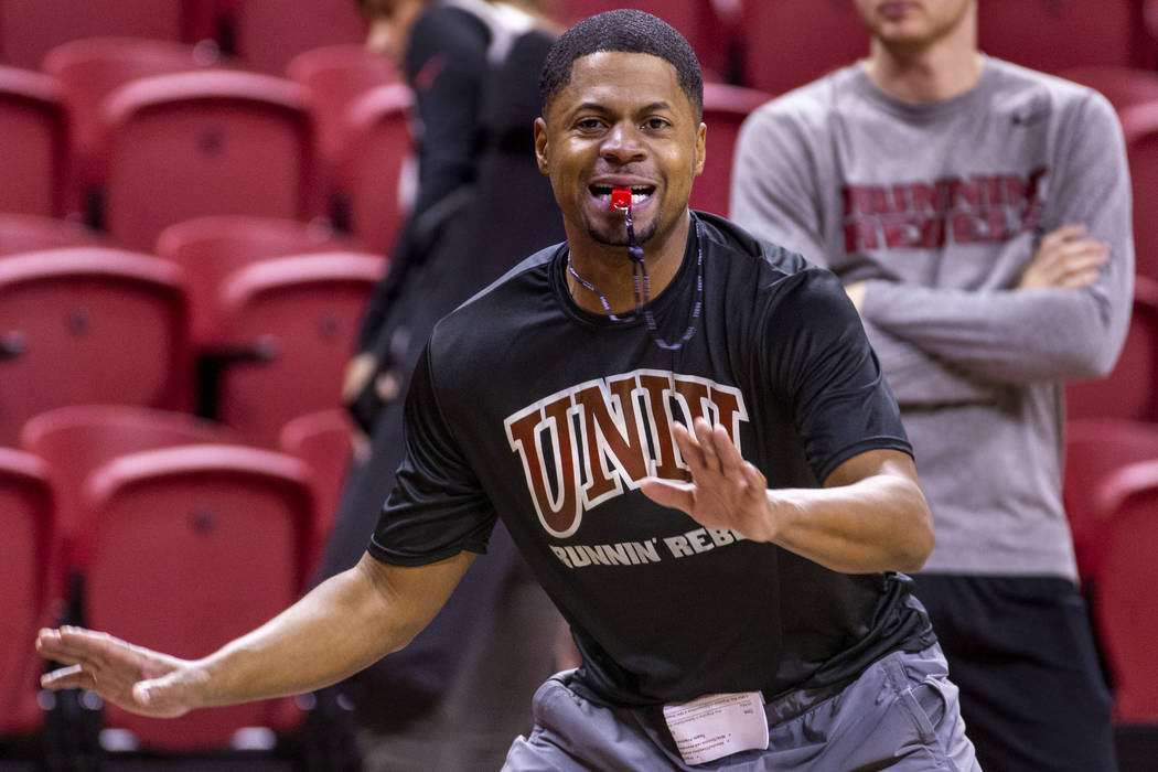 UNLV basketball assistant DeMarlo Slocum works the court as his players practice in the Thomas ...