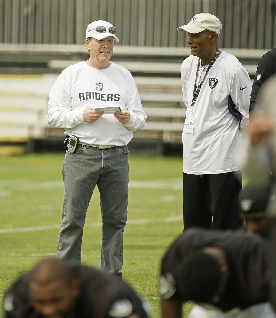 Oakland Raiders owner Mark Davis, left, and Hall of Fame cornerback Willie Brown, right, during ...