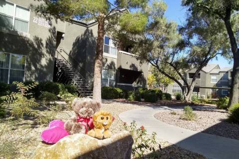 A makeshift memorial is set up outside of a building at the Equestrian on Eastern Apartments, T ...