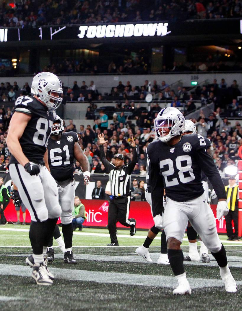 Oakland Raiders Tight End Foster Moreau 87 Congratulates Running Back Josh Jacobs 28 On Sco Las Vegas Review Journal