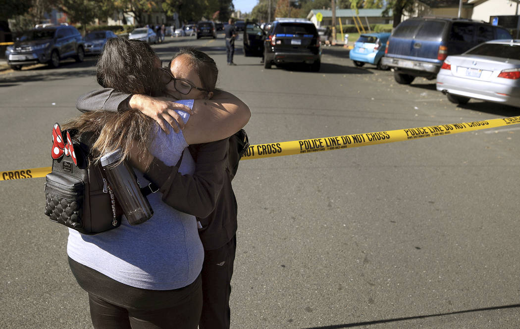 Xiomara Martinez, left, embraces her sister Alondra Moya after Moya and other students were rel ...
