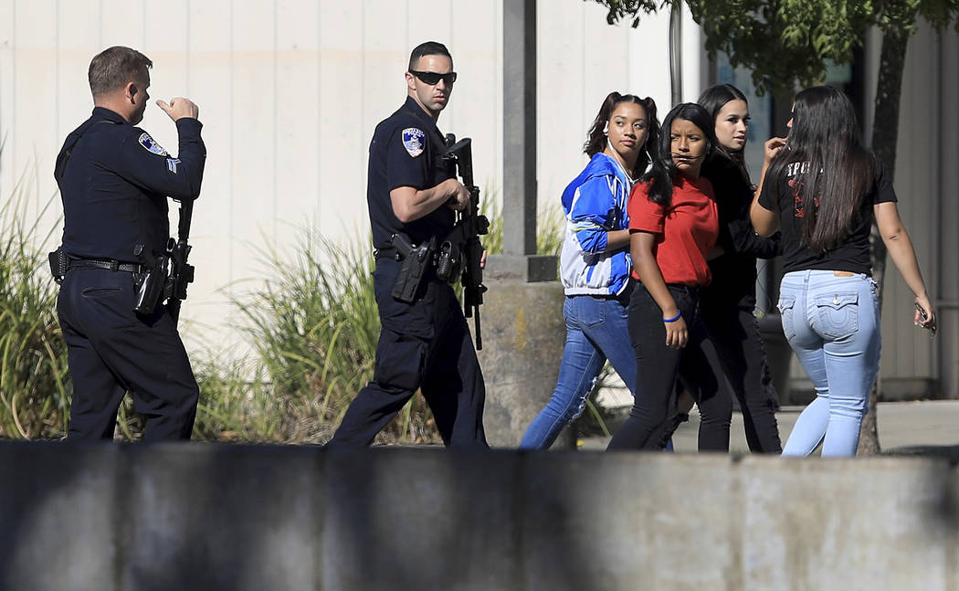 Ridgeway High School students are led back to their classes after the arrest of a suspect who o ...