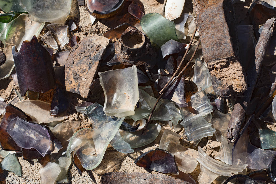 Cracked bottles and debris on the ground in St. Thomas, in the Lake Mead National Recreation Ar ...